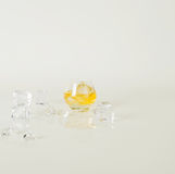 Low round glass with golden alcohol and ice cubes, around a glas Stock Photo