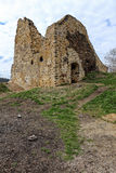 Low ruins of square castle building with entry door Stock Images