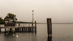 Low saturation Small wooden pier in Lasize, Ialy. Royalty Free Stock Photos