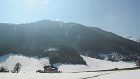 Low season at popular ski resort in mountains, empty hotels, few cars on road