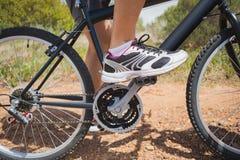 Low section of athletic man mountain biking Royalty Free Stock Photo