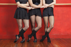 Low Section Of Ballerinas Holding Hands. While standing in studio Stock Images