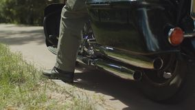 Bikers foot in boots sitting on motorcycle stock video footage