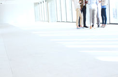 Low section of business people standing together in empty office Royalty Free Stock Photos