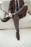 Low section of businessman sitting on couch Royalty Free Stock Photos
