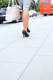 Low section of businesswoman walking on sidewalk Royalty Free Stock Photos