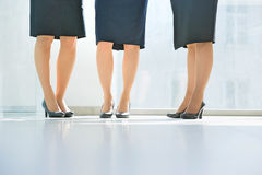 Low section of businesswomen standing in office Stock Photo