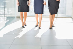 Low section of businesswomen standing on tiled floor in office Royalty Free Stock Photos