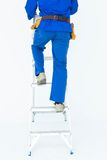 Low section of carpenter climbing step ladder Stock Photography