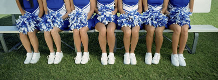 Low Section Of Cheerleaders With Pom-Pom Royalty Free Stock Photo