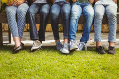 Low section of children in row at park Stock Images
