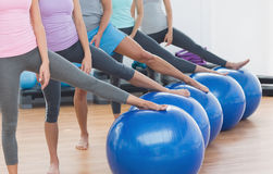Low section of class with exercise balls at fitness studio Royalty Free Stock Photos
