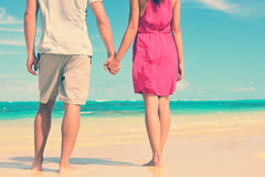 Low Section Of Couple Holding Hands On Beach Royalty Free Stock Images