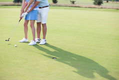 Low section of couple playing golf Royalty Free Stock Photography