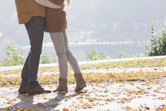 Low section of couple standing in park during autumn Royalty Free Stock Images