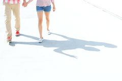 Low section of couple walking on street Royalty Free Stock Image