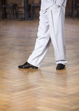 Low Section Of Dancer Performing At Restaurant. Low section of male dancer performing on hardwood floor at restaurant Royalty Free Stock Photo
