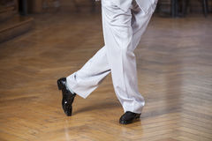 Low Section Of Dancer Performing Tango At Restaurant. Low section of male dancer performing tango on hardwood floor at restaurant Stock Image