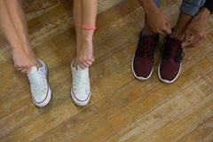 Low section of dancers tying shoelaces Stock Photography