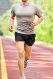 Low Section Of Determined Man Running On Road Royalty Free Stock Photography
