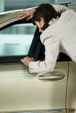 Low section of female customer examining car interior Royalty Free Stock Photo