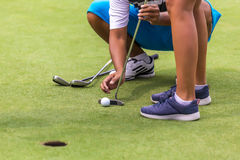 Low section of female golf player Stock Images
