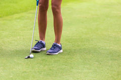 Low section of female golf player Stock Photos