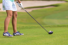 Low section of female golf player Stock Photo
