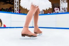 Low section of a figure ice skater. Low section of a female figure ice skater on ice rink royalty free stock images