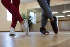 Low section of friends practicing dance on floor Stock Photography