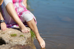 Low Section Of Girl Dipping Foot In Water Royalty Free Stock Image