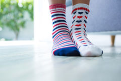 Low section of girl wearing different socks Stock Photos
