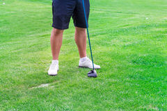 Low section of golf player ready to hit the ball Royalty Free Stock Photos