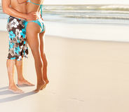 Low section image of a couple at the sea shore Royalty Free Stock Image