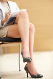 Low section image of legs of a working woman Royalty Free Stock Image