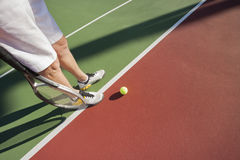 Low section of male tennis player on court Royalty Free Stock Image