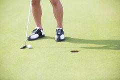 Low section of man with golf club and ball Royalty Free Stock Photography