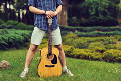 Low section of man with guitar Stock Images