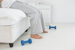 Low section of a man in pajama lying in bed Stock Photo