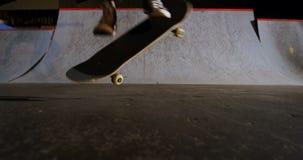 Man practicing skateboarding in skateboard arena 4k. Low section of man practicing skateboarding in skateboard arena 4k stock footage
