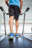 Low section of a man running on treadmill Royalty Free Stock Photos