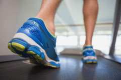 Low section of a man running on treadmill Royalty Free Stock Image