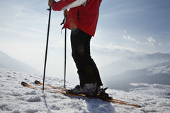 Low Section Of Man On Ski Vacation Stock Photo