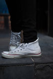 Low section of man wearing white canvas shoes Royalty Free Stock Photography