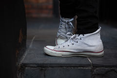 Low section of man wearing white canvas shoes Royalty Free Stock Images