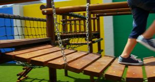 Low section of mixed-race schoolgirl playing in school playground on a sunny day 4k stock video footage