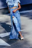 Low section og afro girl in jeans clothes posing for fashion shoot. On parking stock images