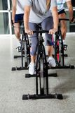Low Section Of People On Exercise Bikes Royalty Free Stock Photography