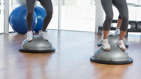 Low section of people performing step aerobics exercise Stock Image