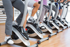 Low section of people working out at spinning class Stock Photography